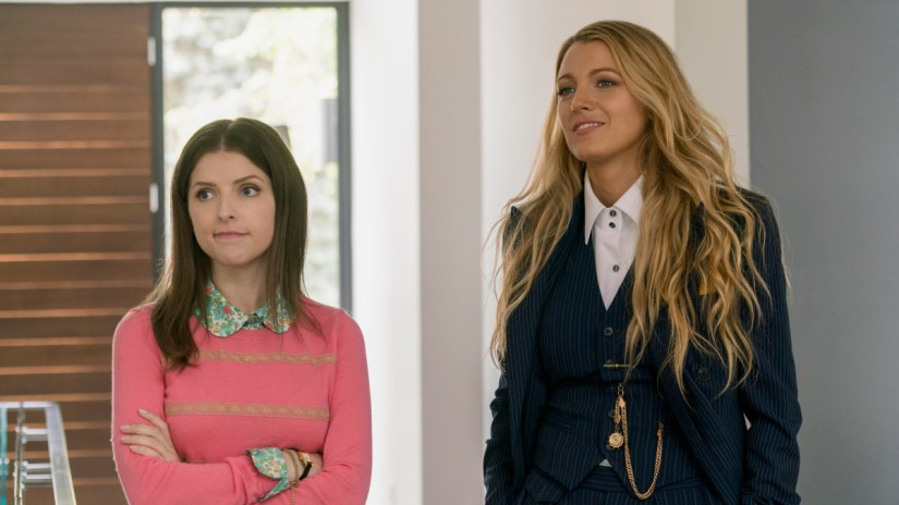 a-simple-favor-anna-kendrick-pink-sweater-blake-lively-suit